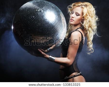 dancer girl in smoke with disco ball - stock photo