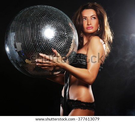 dancer girl in smoke with disco ball - stock photo