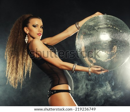 dancer girl in smoke with disco ball, night club - stock photo