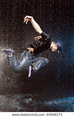 Dancer in aqua studio in motion - stock photo