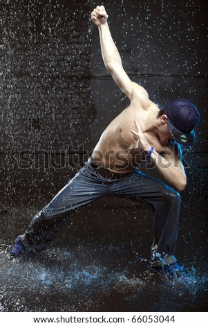 Dancer in aqua studio without T-shirt - stock photo