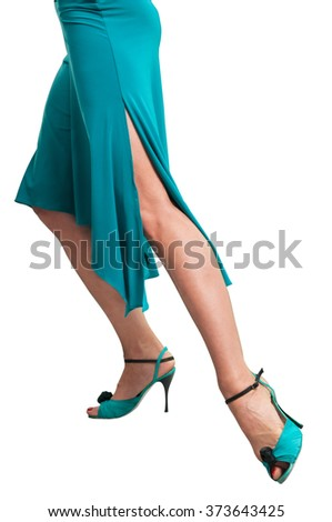Dancer in ballroom dance shoes makes movement  isolated on white background - stock photo