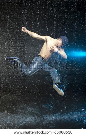 Dancer in motion in aqua studio - stock photo