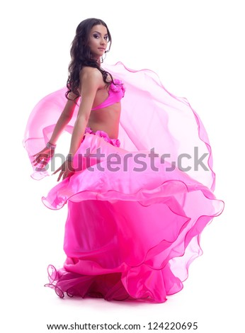 Dancer in pink costume performing oriental dance - stock photo