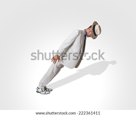 dancer performing lean move. isolated, studio image - stock photo