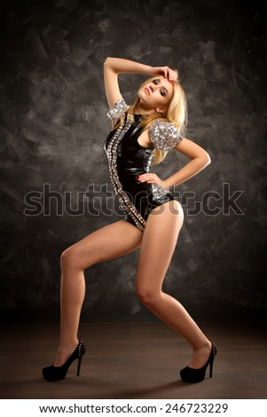 dancer posing against the wall. beautiful girl in the studio. lifestyle - stock photo