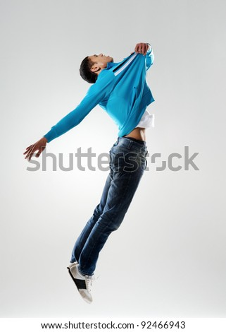 dancer pulls himself off the floor in a levitation sort of way as if he didnt jump at all - stock photo
