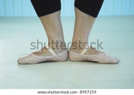 Dancer's feet during studio practice. - stock photo