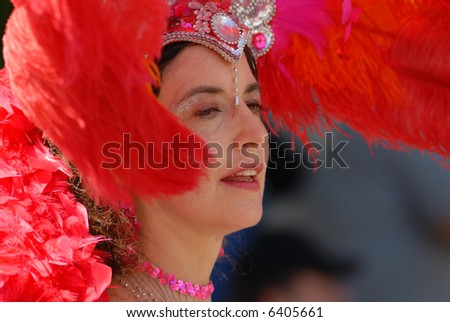 Dancer with big red feather hat
