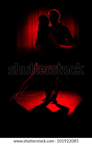 Dancers. A couple of professional latino dancers. - stock photo