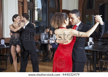 Dancers Doing Tango While Couple Dating In Restaurant