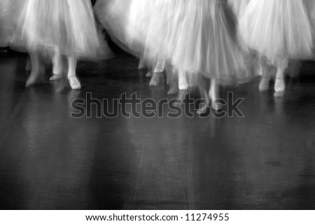 Dancers on stage during a recital. Lots of motion evident - B&W - stock photo