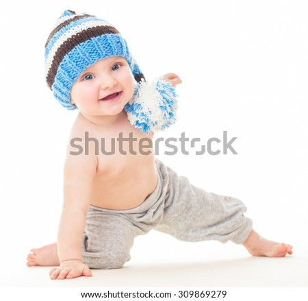 Dancing baby. cheerful baby in the hat. Beautiful happy baby . One,isolated on white. Laughing baby. - stock photo