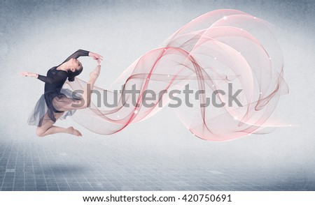 Dancing ballet performance artist with abstract swirl concept on background - stock photo