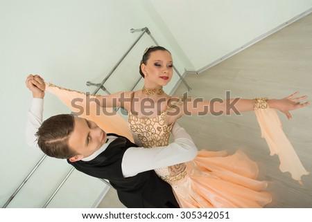 Dancing, ballroom dancing, dance studio, man and woman - stock photo