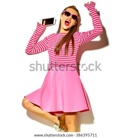 dancing beautiful happy cute smiling sexy brunette woman girl in casual colorful pink summer clothes with red lips isolated on white listening to music