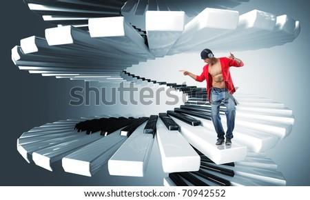 dancing caucasian man with headphone on virtual piano keyboard - stock photo