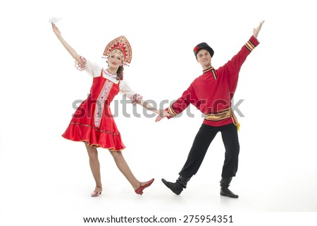 Dancing couple in russian national costumes hold hands  - stock photo