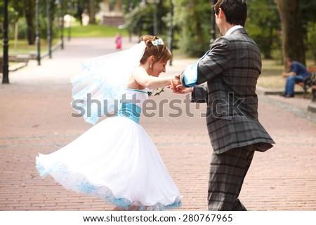 dancing couple on the background park - stock photo