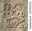 Dancing devatas - stone engraving on the wall of the Bayon Temple in Siem Reap, Cambodia - stock photo