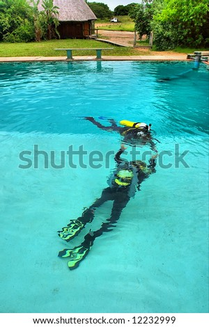 Dancing divers. Shot in training pool, Sodwana Bay, KwaZulu-Natal province, Southern Mozambique area, South Africa. - stock photo
