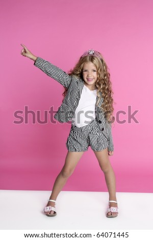 dancing full length little girl on pink studio background - stock photo