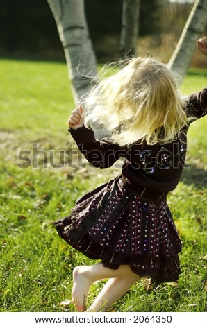 Dancing girl in motion - stock photo