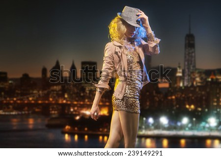 Dancing girl over night city background - stock photo