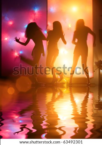 Dancing girls silhouettes in front of colorful disco lights - stock photo