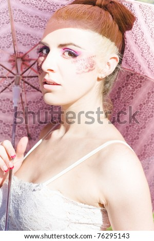 Dancing In The Rain Is A Ballerina In Pretty Lace Cosmetics Holding A Summer Shade Umbrella Outdoors While Doing A Rainy Sunshine Dance - stock photo
