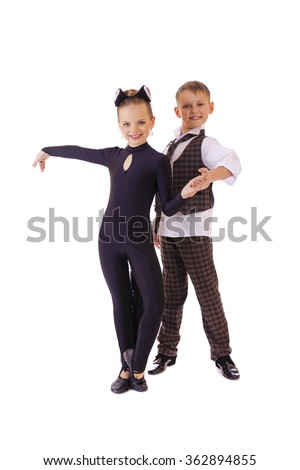 Dancing little girl dressed as a cat and a boy in a plaid vest, isolated on white background - stock photo