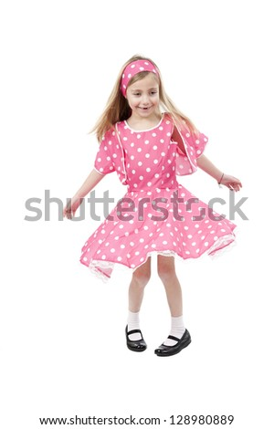 Dancing little girl in pink dress, isolated on white background - stock photo