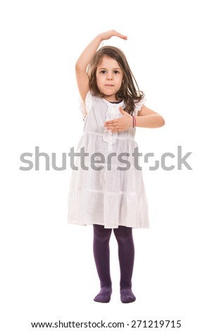 Dancing little girl stretching hands isolated on white background - stock photo