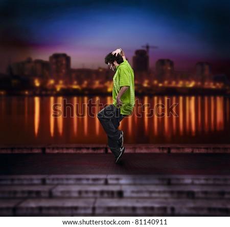 dancing man over night city - stock photo