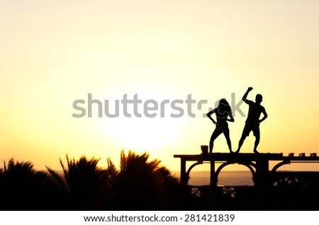Dancing on the roof at sunrise. - stock photo