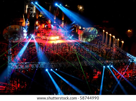 dancing people at night outdoor concert - stock photo
