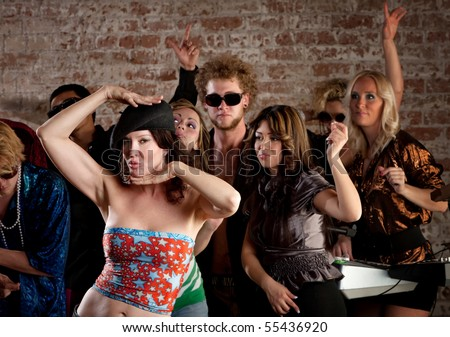 Dancing people at 1970s Disco Music Party - stock photo
