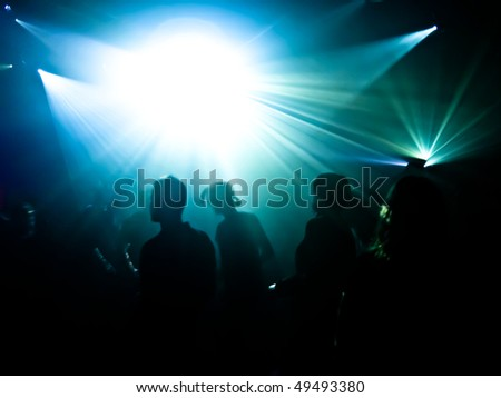 Dancing people in a disco - stock photo