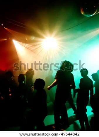 Dancing people in a disco