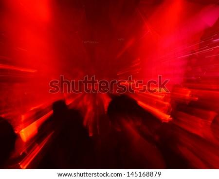 Dancing people in a disco, nightclub. - stock photo