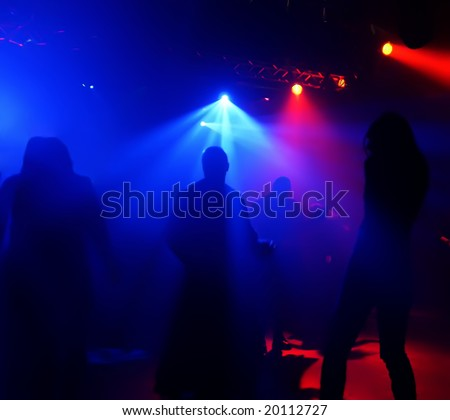 Dancing people in an underground club