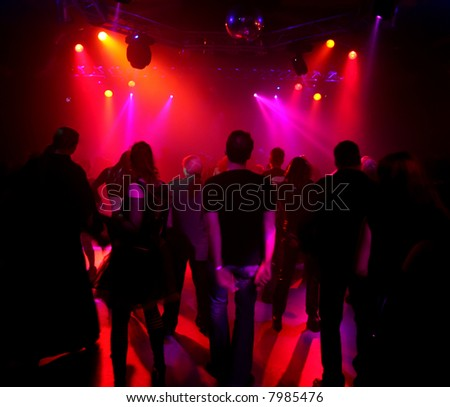 Dancing people in an underground club - stock photo