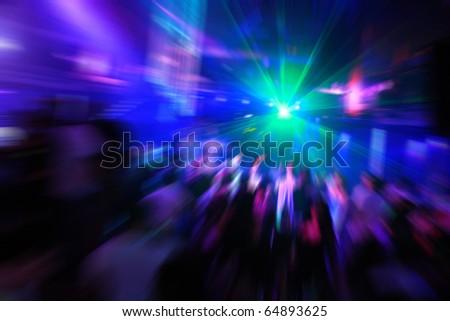 dancing people radial blur effect in Laganas Zakynthos Greece - stock photo