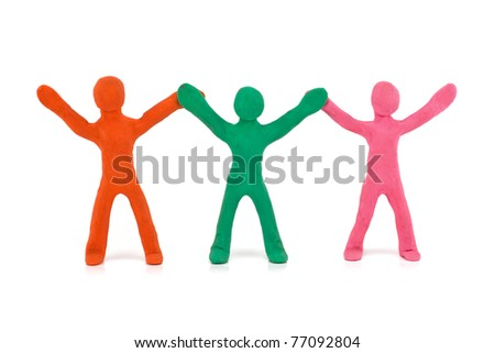 dancing plasticine figurines isolated on white background - stock photo