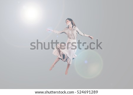 stock photo dancing queen studio shot of attractive young woman in beautiful dress hovering in air 524691289 woman levitating stock images, royalty free images & vectors  at bayanpartner.co