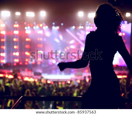 Dancing silhouette of woman in a nightclub - stock photo