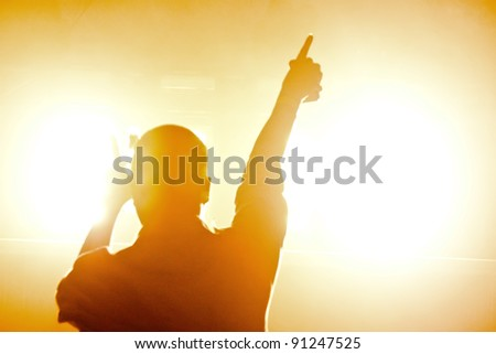 dancing silhouettes of man in a nightclub - stock photo