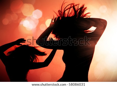 dancing silhouettes of woman in a nightclub - stock photo