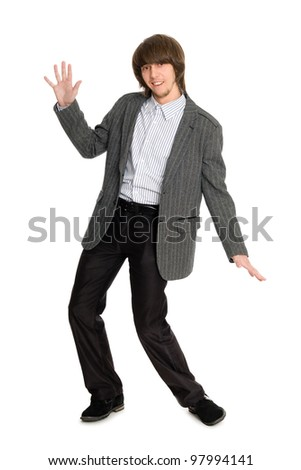 Dancing stylish young man on a white background.