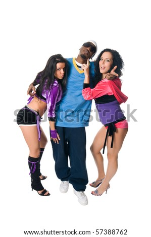 Dancing team of cool male and two go-go girls - stock photo